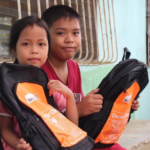 Children receive school supplies for new school year