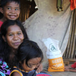 Ompong-affected families receive sacks of rice and corn seeds