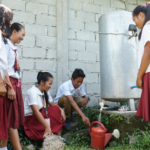 A sponsor's gift to his sponsored child – water for his school