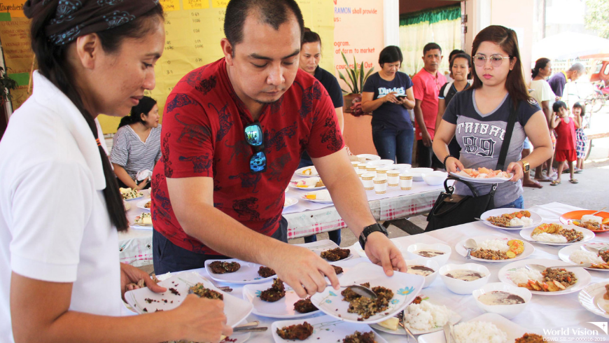 Food preparation during Pinoy Nutrition Hub session where health workers are taught how to prepare balanced nutritious food to cure malnutrition among children.