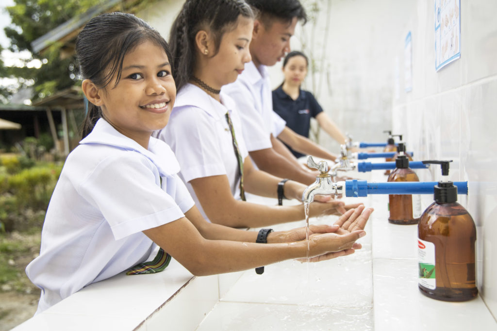 Students from a far-flung school in the Philippines receive assistance from World Vision for repair and building of their gender-segregated comfort rooms, hand washing and water pump.
