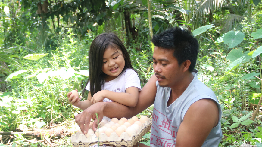 Every day, 6-year old Charmaine would join his father Richard in visiting the native chickens they received from World Vision a year ago.