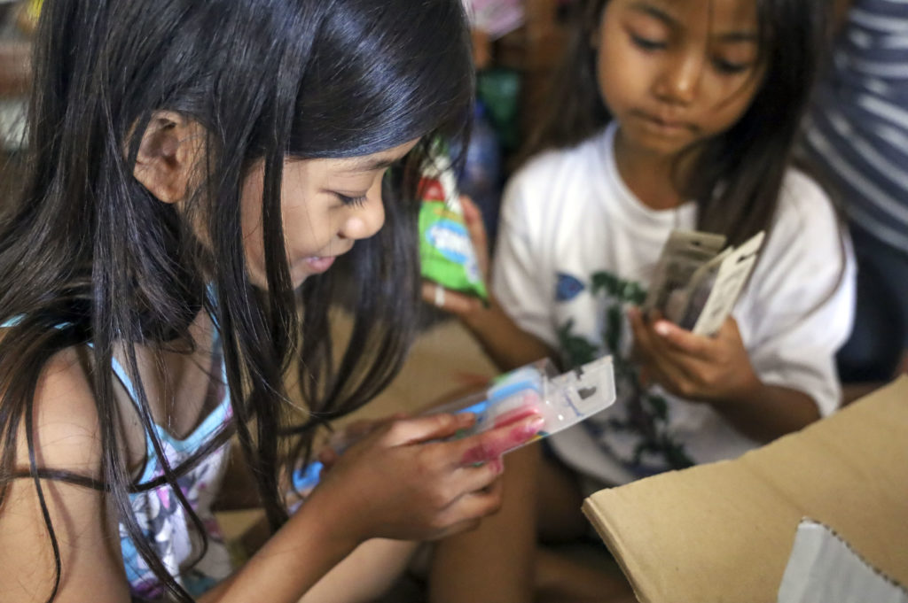 The sisters, along with their parents and two older sisters, have been staying in a cramp evacuation center for a week now. The family live in the municipality of Laurel, Batangas, one of the hardest hit areas of Taal volcano eruption.