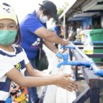 Child reminds other children to wash hands always